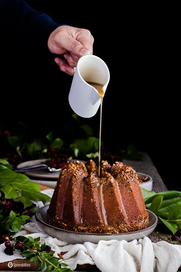 The drizzle for Pecan Pie Bundt Cake is made of brown sugar, butter, and cream. Greek Woodland Honey with Sage makes this cake extra moist. Spoonabilities.com