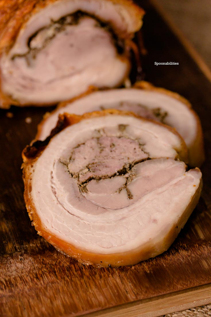 Pork Porchetta is an Italian recipe using pork belly seasoned with fennel, garlic, pepper & other herbs. Moist roasted meat with a crispy skin. Spoonabilities.com