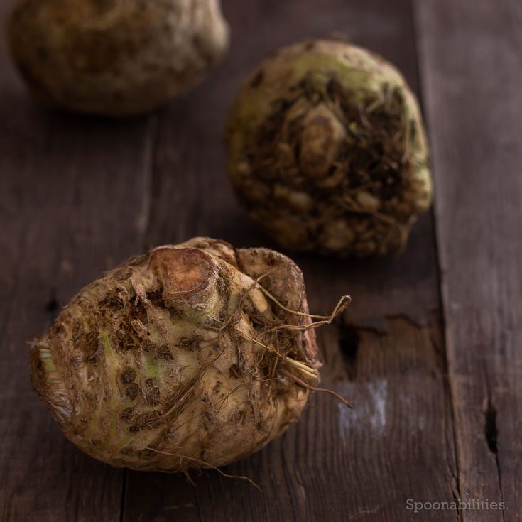 Three Raw Celery Root on a wooden board. Celery Root is low in cholesterol & saturated fat, and high in vitamins. Healthy soup recipe. Spoonabilities.com