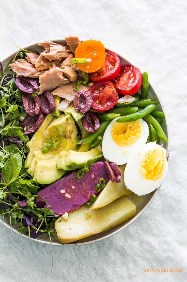one large bowl of Classic Nicoise Salad on a gray linen tablecloth