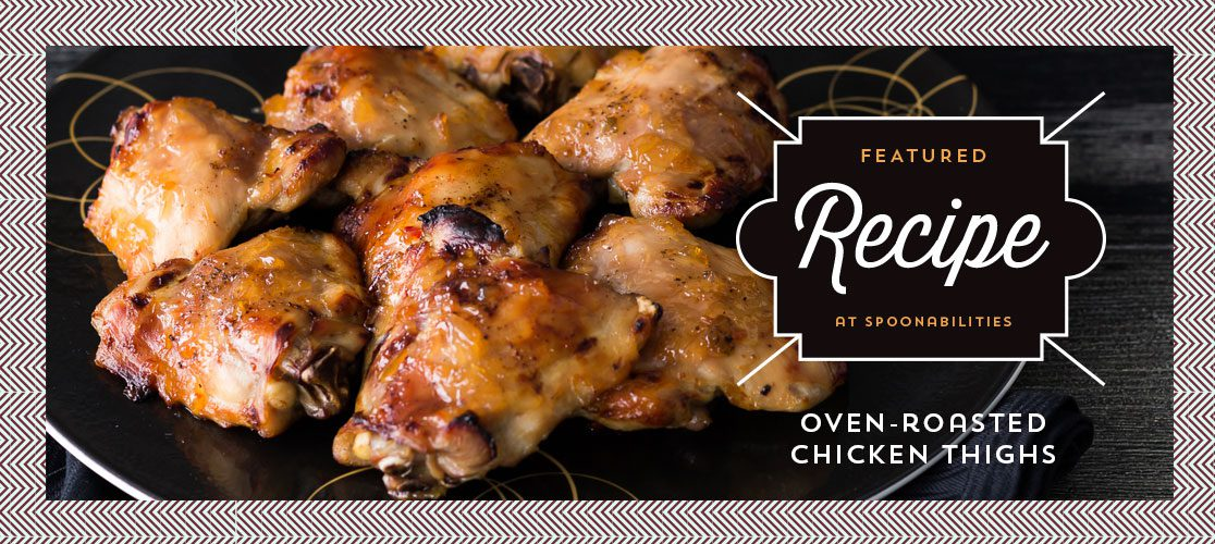 Oven-roasted Chicken Thighs on a dark plate. Sticky finger-licking goodness that's a super easy recipe