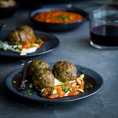 Easy lamb meatball recipe appetizer made with fresh herbs & spices. Served in a bed of Greek yogurt & a flavorful piquillo peppers pesto. Ready in 15 minutes. Spoonabilities.com