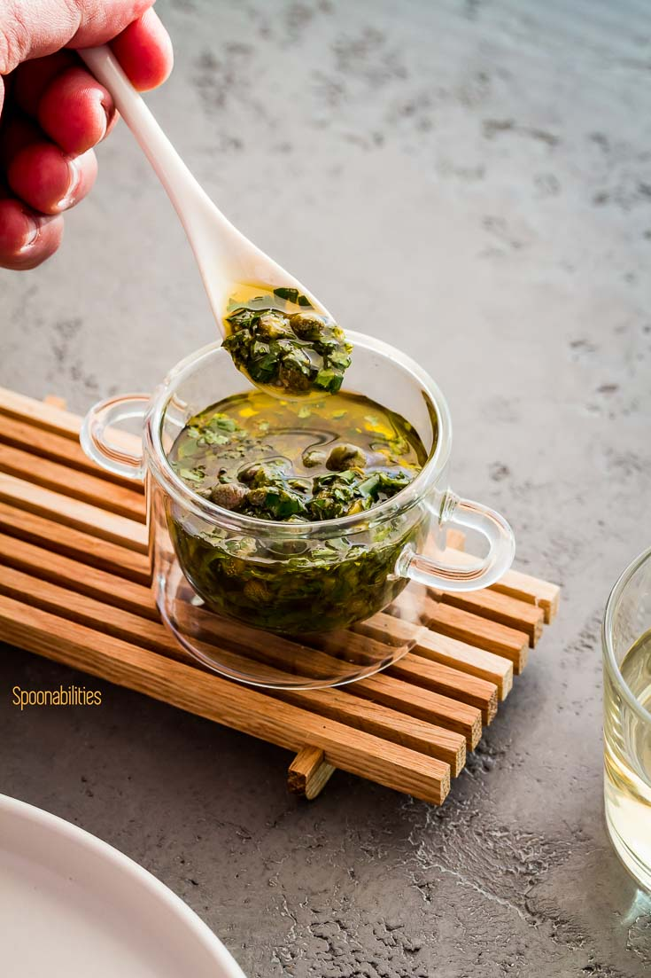 Glass Bowl with caper salsa is made with fresh parsley, chili paste, cilantro, olive oil and lemon juice. Spoonabilities.com