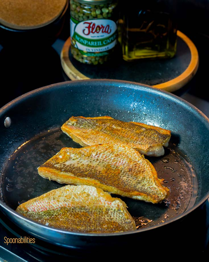Crispy skin snapper in the fry pan in the stove. Spoonabilities.com
