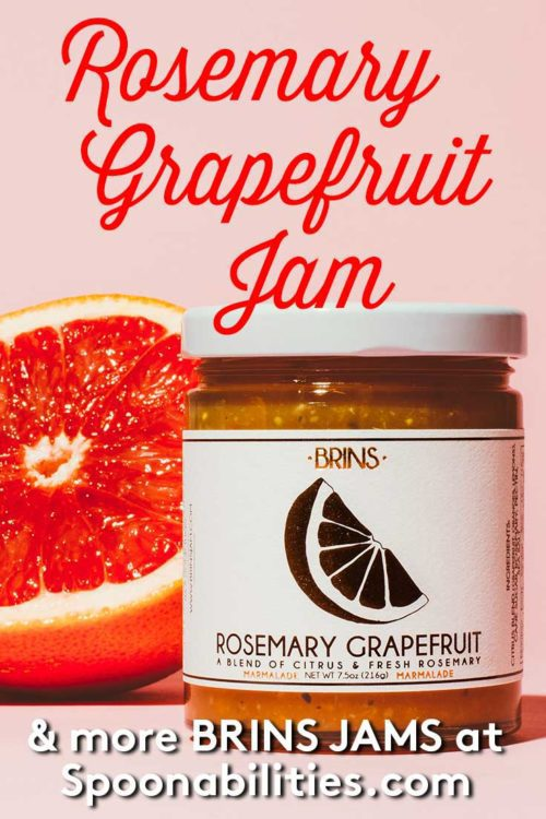 jar of BRINS Rosemary Grapefruit Jam next to a half grapefruit