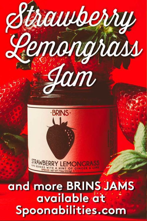 jar of BRINS Strawberry Lemongrass Jam surrounded by fresh red strawberries
