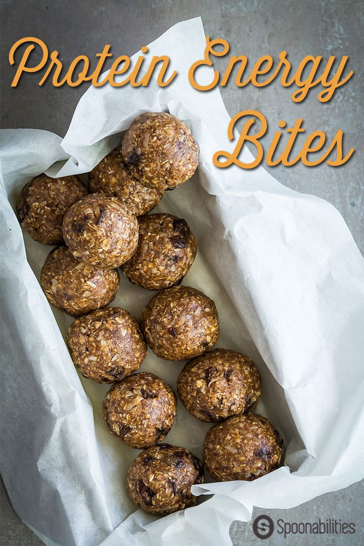 Protein Energy Bites are easy to make and no baking is required. Healthy snack bites loaded with quick-oats, almond butter, cocoa nibs, raisins, unsweetened coconut flakes, honey, and protein meal replacement by Naked Nutrition.