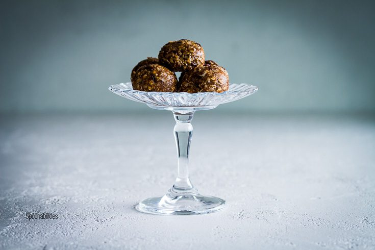 Five Protein Energy Bites in a glass pedestal. No bake Homemade healthy snacks recipe. Spoonabilities.com