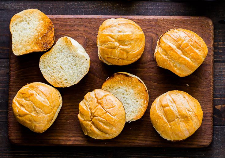 Six Baguette style toasted burger buns. Spoonabilities.com