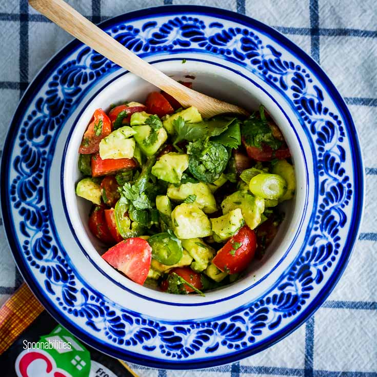 Cherry Tomato Avocado Salsa in a small blue & white round bowl. Spoonabilities.com