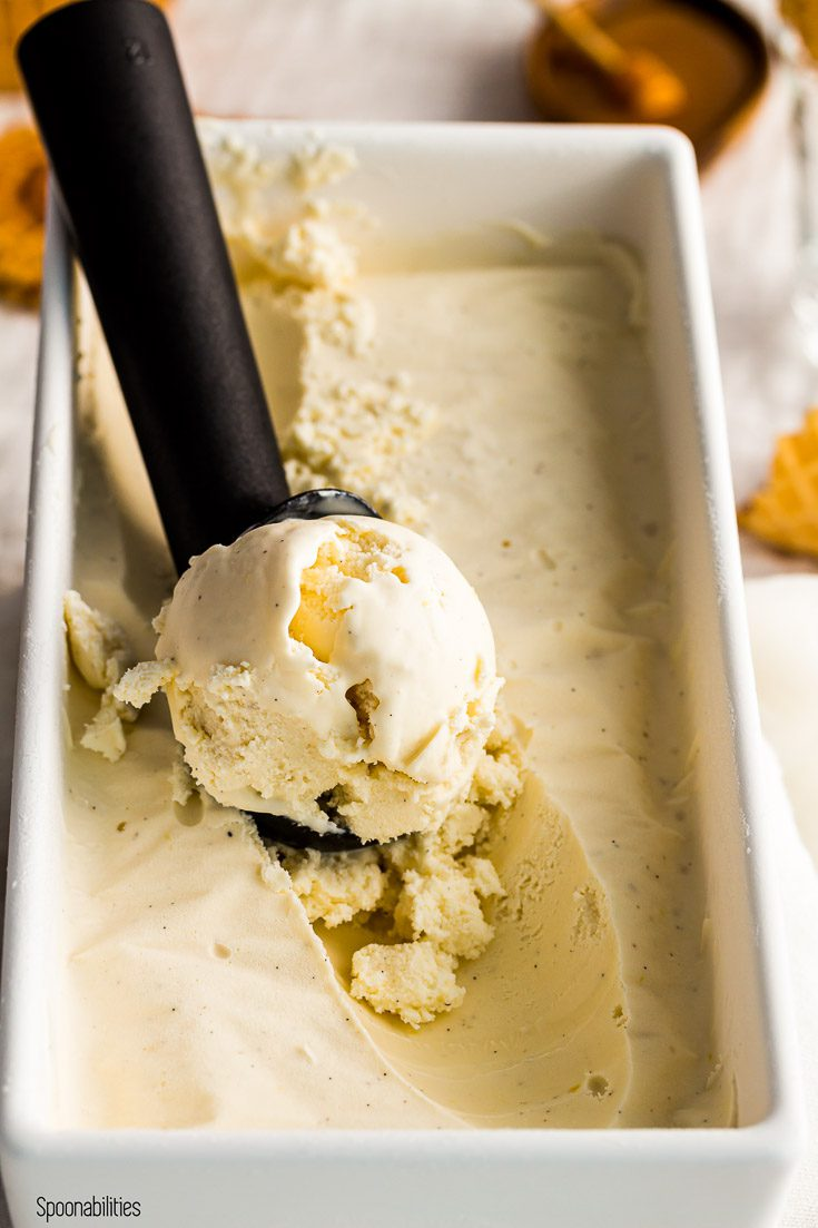 Close up of the homemade honey Labneh ice cream with a scoop. Spoonabilities.com