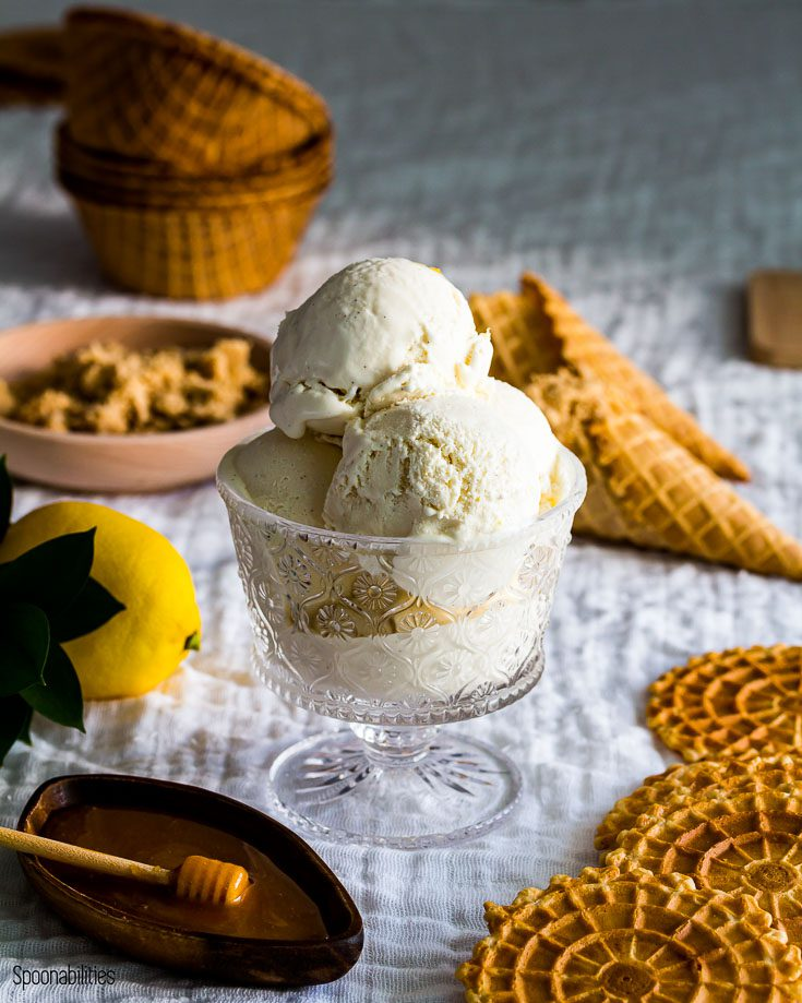 Three scoop of homemade labneh ice cream with waffle cones in the background.