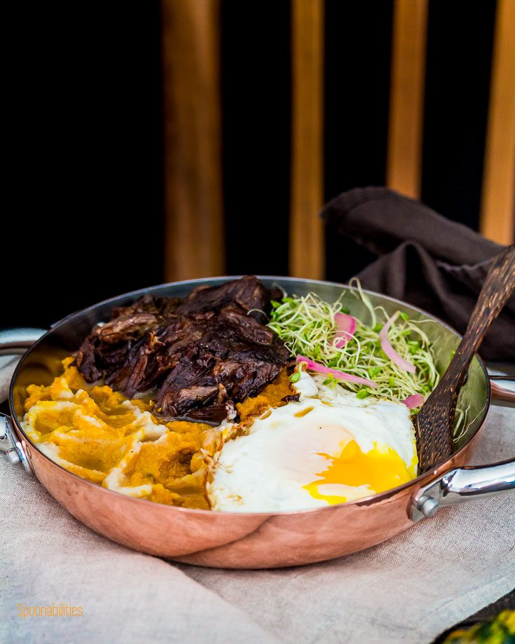 Cooper personal fry pan with Mashed Pumpkin-Cauliflower seasoned with brown butter, crispy fried egg with runny yolk, Alfalfa Sprouts, pickled red onions and braised short ribs with brandy and Middle East spices. spoonabilities.com