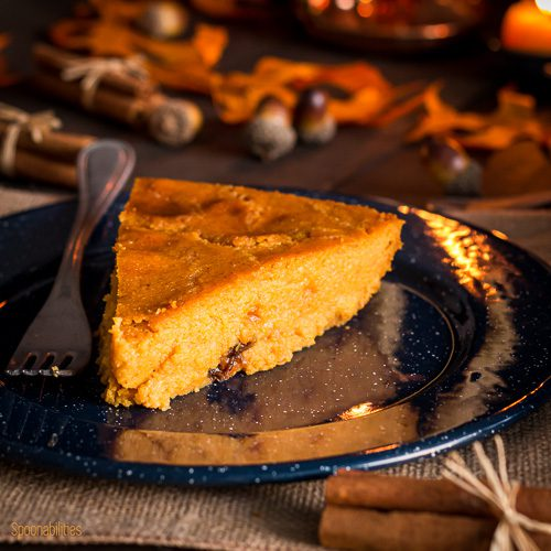 Blue plate with a piece of Cornmeal Coconut Cake with pumpkin. Spoonabilities.com