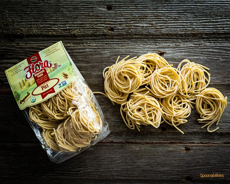 Flora Fine Foods Organic spaghetti Pici pasta in the package and another one outside the package. Spoonabilities.com
