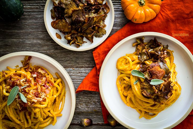 overhead photo with two bowl with pasta and Pumpkin Pasta Sauce, and one small plate with crispy oyster mushrooms. Spoonabilities.com