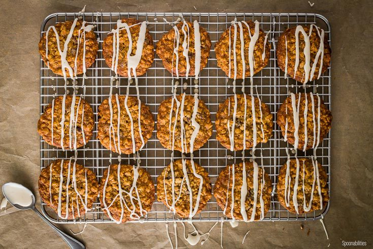 Cookies in a cooling rack with the maple glaze drizzle. Spoonabilities.com