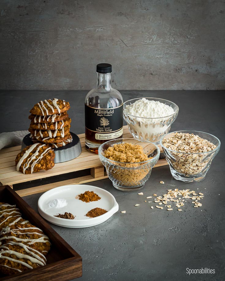 The picture shown the ingredients of the oatmeal cookies for example oatmeal, brown sugar, all purpose flour, spices and Mansfield Maple Syrup Bourbon flavor. Available at spoonabilities.com
