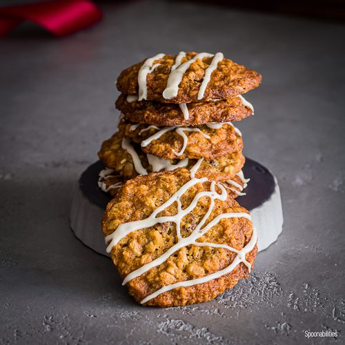 A tower of Oatmeal Raisin Maple Bourbon Cookies with Maple Syrup Glaze. Spoonabilities.com