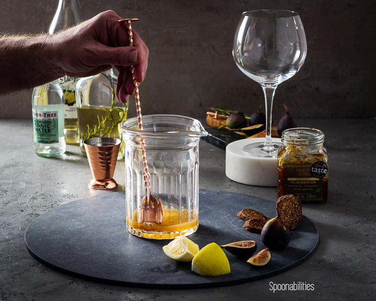 Mixing Fig Marmalade and lemon juice in a glass pitcher