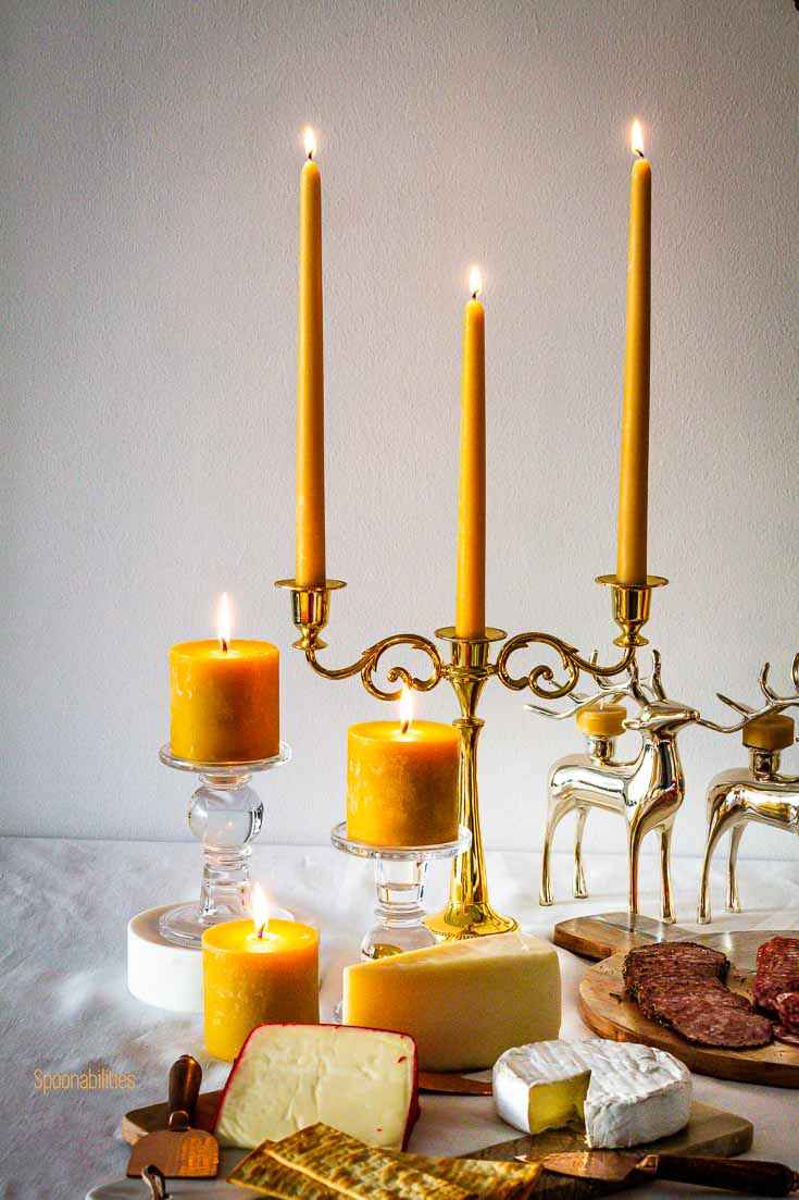 Beeswax taper candles are a timeless staple in home décor. We placed the tapers in a golden Candle stick holder. Spoonabilities.com