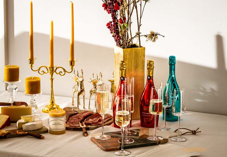 Celebration table with prosecco, charcuterie, cheeses and different Types of Candles. Spoonabilities.com