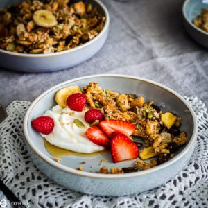 Easy Grain-Free Granola recipe with Nuts, Seeds & Coconut in a cereal bowl. Recipe at Spoonabilities.com