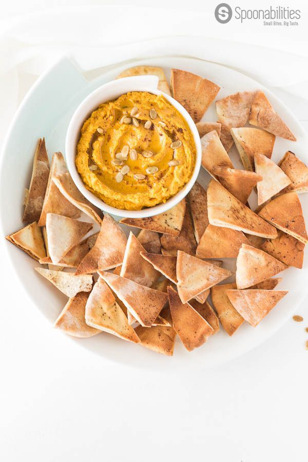 Pumpkin Hummus has earthy flavor. What a great appetizer recipe to bring to your next fall holiday parties. Pumpkin hummus is a great option for your Thanksgiving dinner, and is very easy to make. Mix chickpeas, Pumpkin Puree, Tahini, Garlic, Parsley. Spoonabilities.com