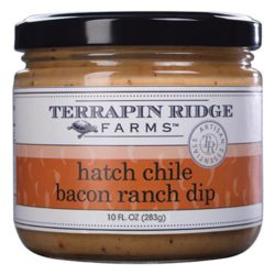 Hatch Chile Bacon Ranch Dip is made from prized chiles from Hatch, New Mexico, which are folded into whipped cream cheese. It is delicious on bagels and wraps, whisked into scrambled eggs, or as a dip for your favorite chip!