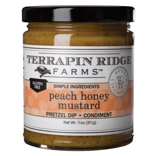 Peach Honey Mustard is rich, sweet and tangy. Its uses are endless: it is delicious as a glaze for a pork roast or roast turkey, a perfect garnish for cheeses and vegetables, and will take your baked brie to a whole new level!