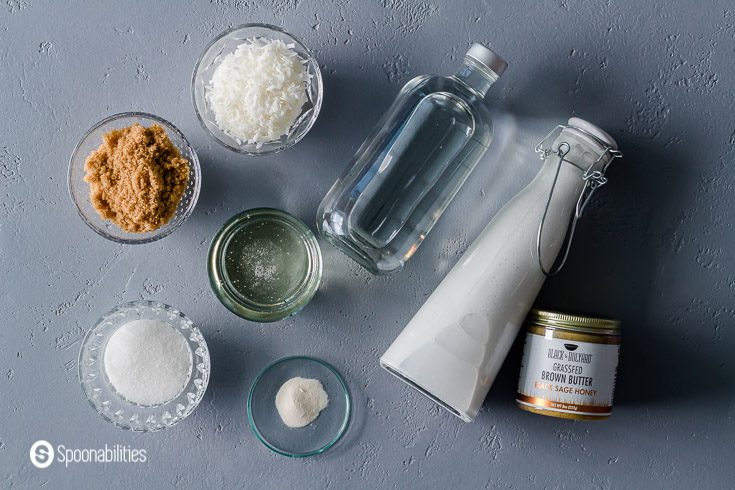 Ingredients for the coconut ice cream: white & brown sugar, water, coconut flakes, brown butter, xanthan gum, corn syrup, and coconut cream. Recipe at Spoonabilities.com