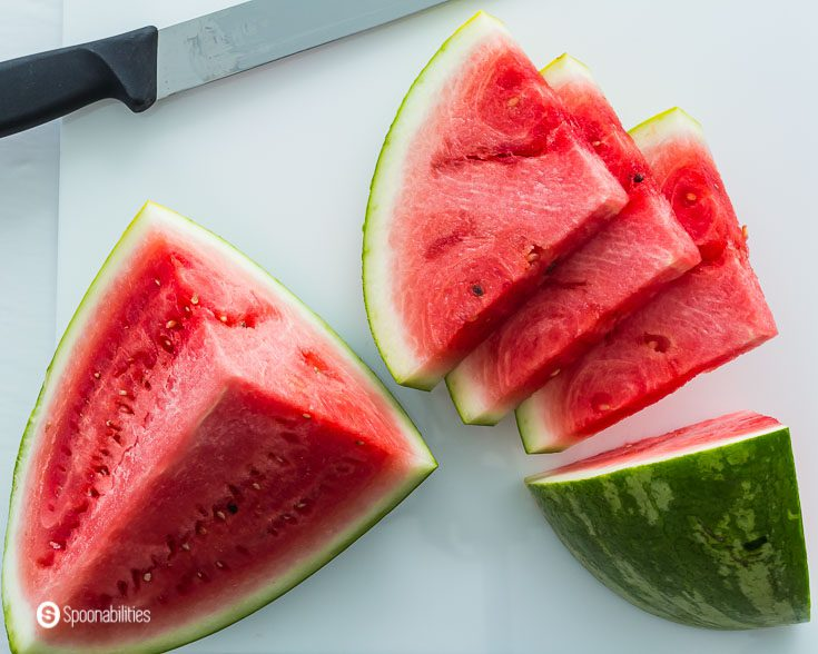 2 large sections of watermelon with 3 cut slices