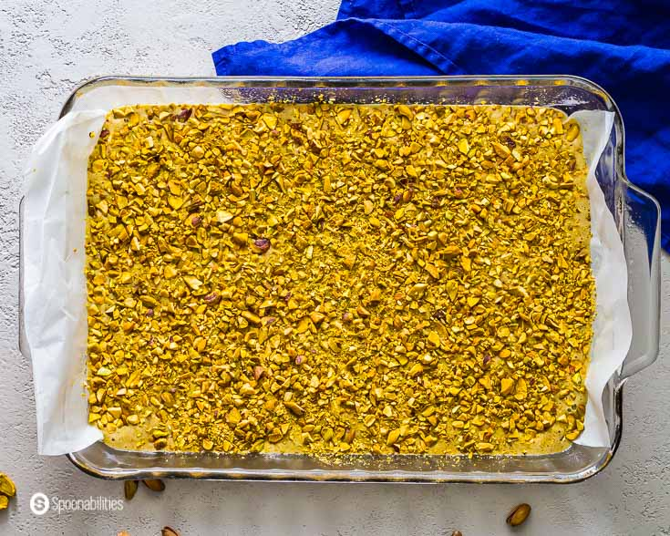 Baking dish with the pistachio cake batter before go into the oven. Recipe at Spoonabilities.com