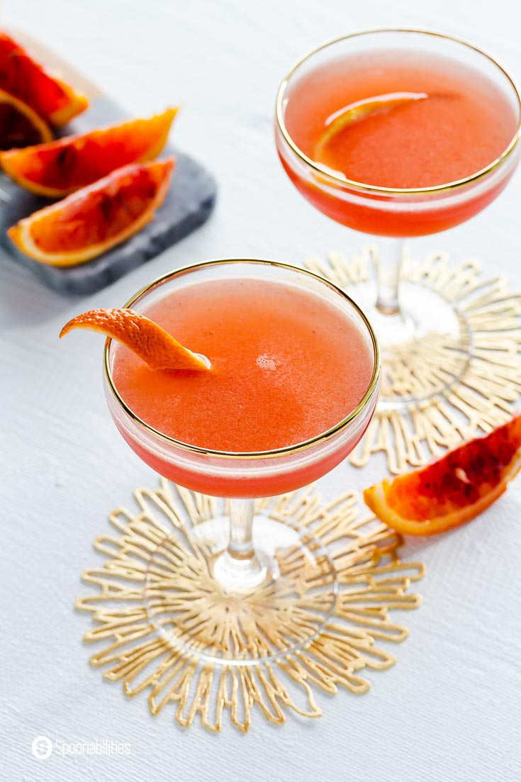 Overhead photo of the Couple glass with blood orange liqueur. Recipe at Spoonabilities.com
