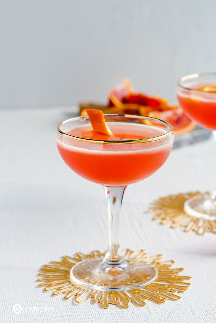 Close up of a coupe glass with Solerno Cocktail and garnished with a blood orange ring. Recipe at spoonabilities.com