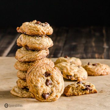 A tower with six of the The best Chocolate Chip Cookies recipe and one cookie facing you with three chocolate chips. Recipe at Spoonabilties.com