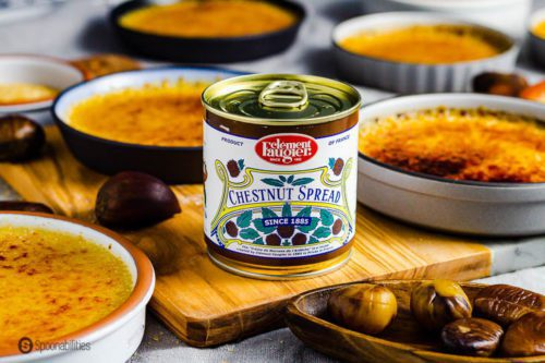 A can of Clément Faugier chestnut spread. This is a top French Gourmet product available at Spoonabilities.com - The can is surround several Crème brûlée in a small ramekins. Recipe at Spoonabilities.com