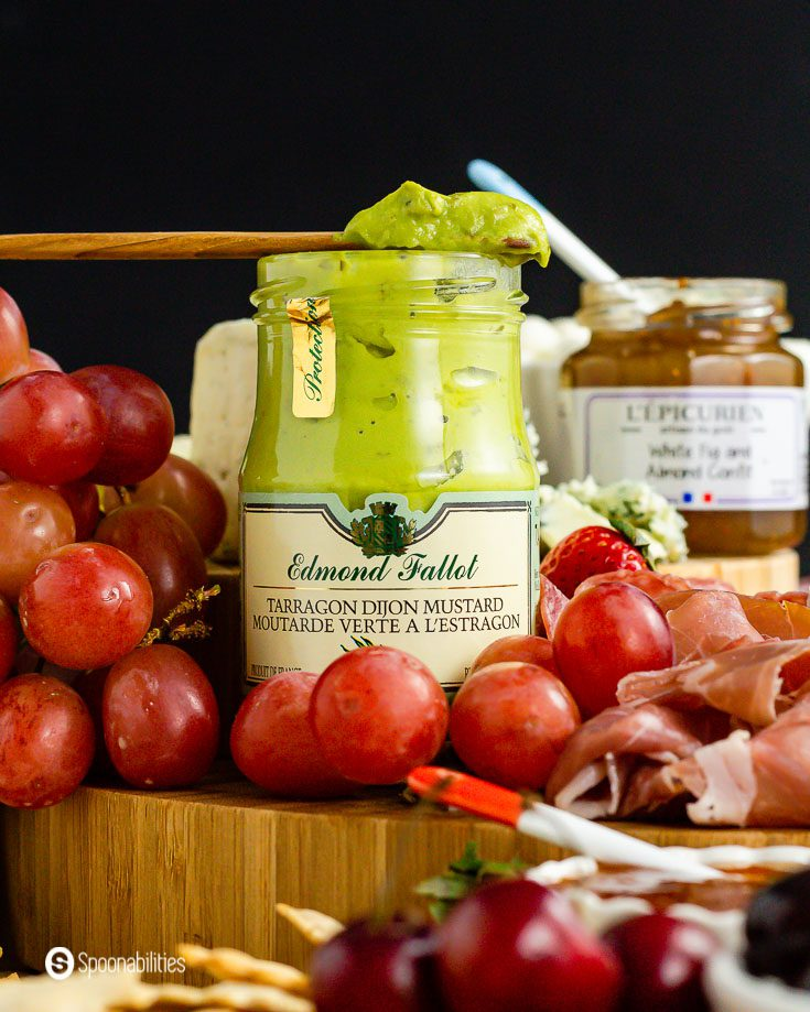 A close up with a jar of the Edmond Fallot's Tarragon Dijon Mustard. This gourmet product is available at Spoonabilities.com