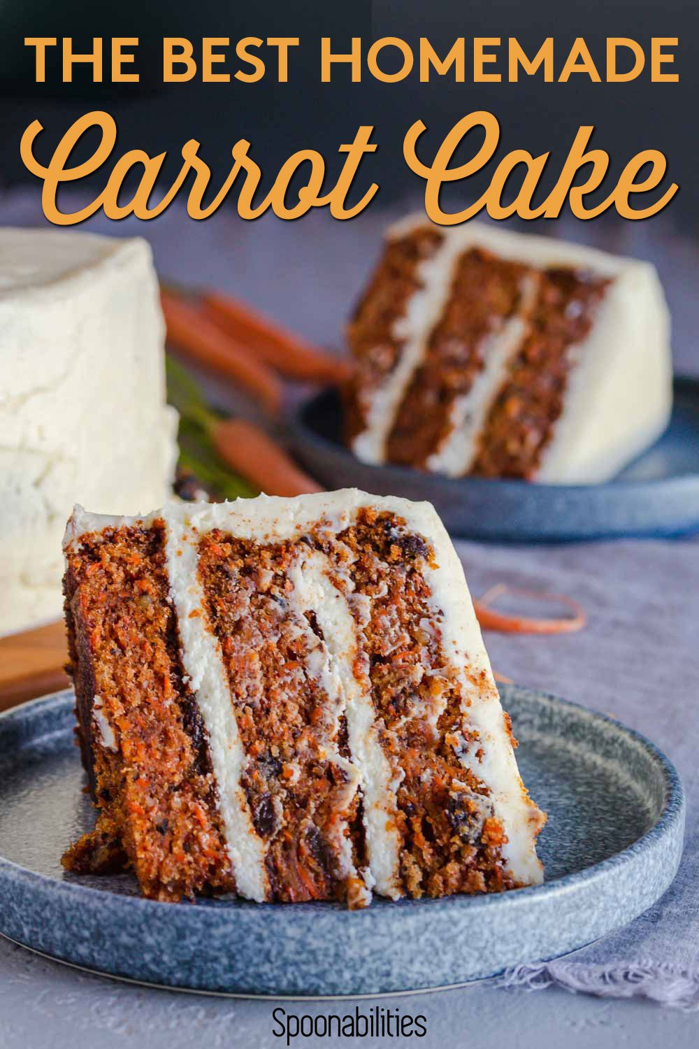 A slice of the BEST carrot cake on a blue round plate. in the background, the cake in the stand, and another serving. Recipe at Spoonabilities.com
