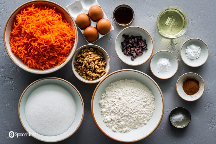 Ingredients for the cake: Carrots, flour, sugar, nuts, salt, spices, eggs, oil, raisings, and more. Find out all the ingredients for this cake recipe at Spoonabilities.com