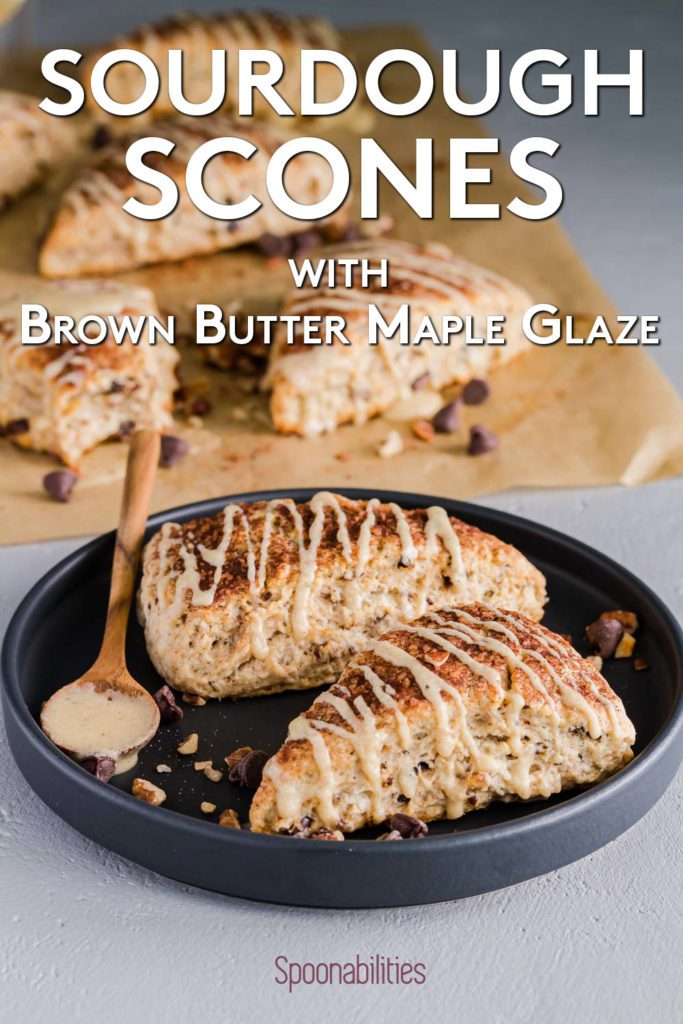 Black round plate with two sourdough scones drizzled with Brown Butter Maple Glaze. Recipe at spoonabilities.com