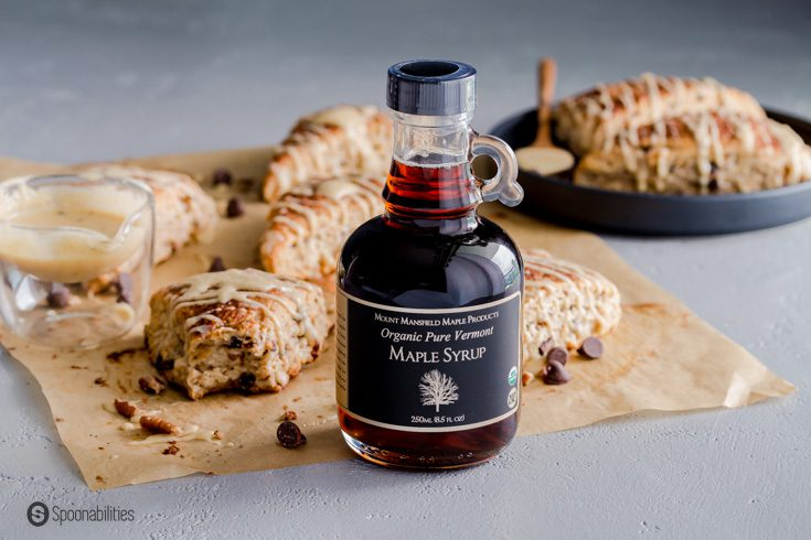A bottle of Organic Maple syrup and in the background sourdough scones. Recipe at spoonabilities.com