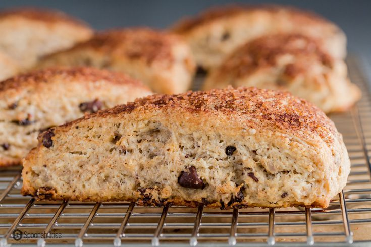 A close up photo of the scone showing the filling with chocolate chips and nuts. Recipe at Spoonabilities.com