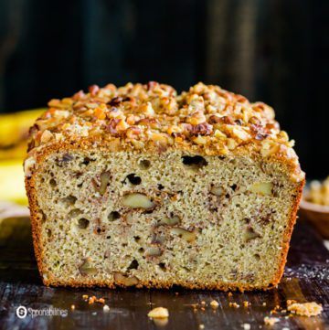 A close up photo of the sourdough banana bread Recipe. You can see the the crumb with pieces of nuts. Recipe at Spoonabilities.com